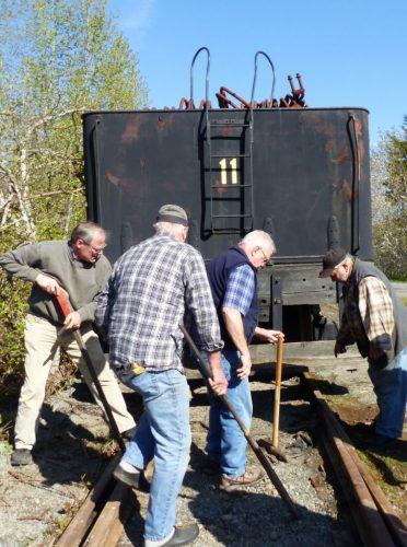 volunteers restoring industrial heritage artifacts