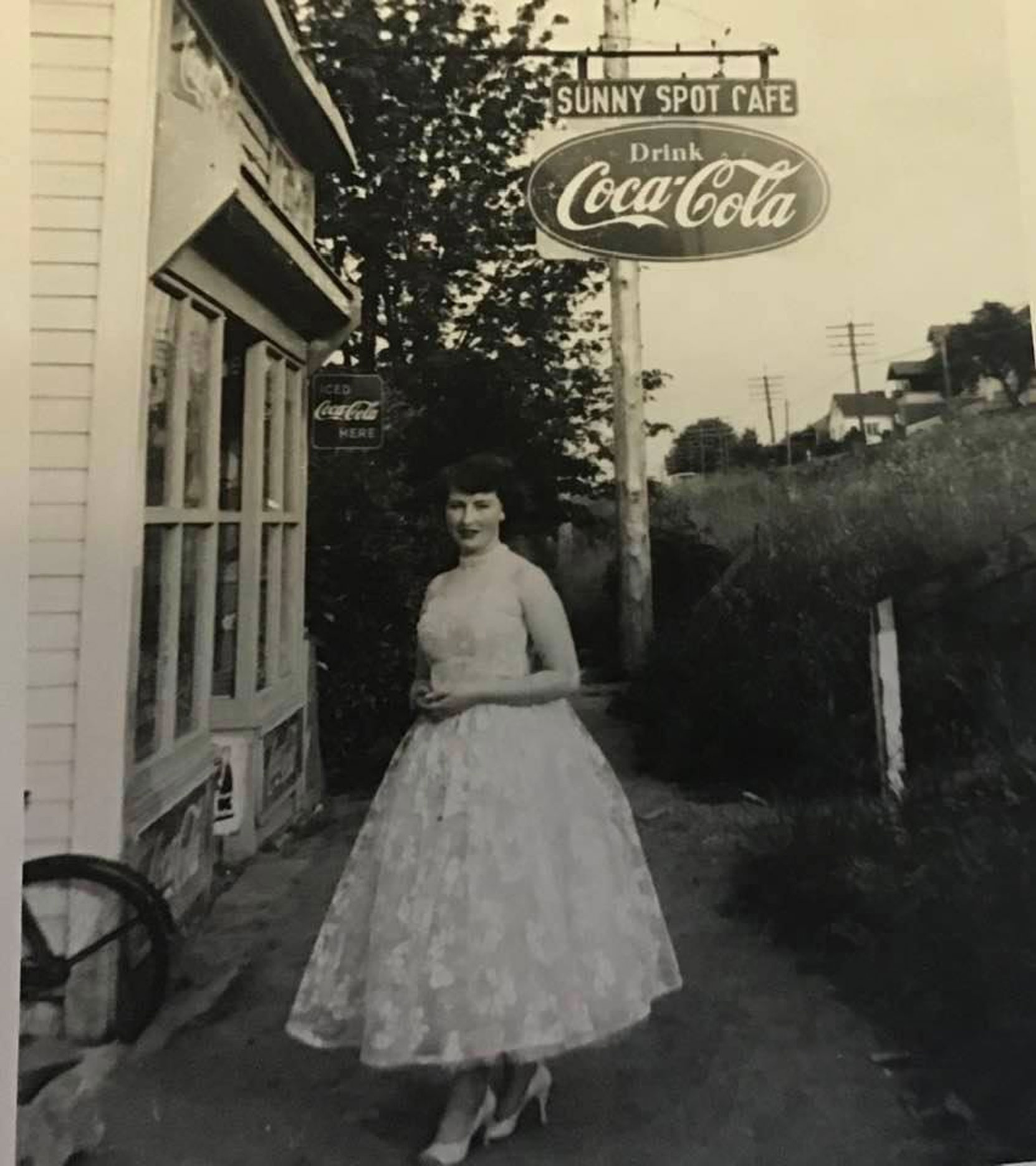 Maralyn McKendrick, who lived at 321 1st Avenue, in front of the Sunny Spot Cafe, 317 1st Avenue, 1957. (photo: Hilary Hansen, family photo - used with permission)