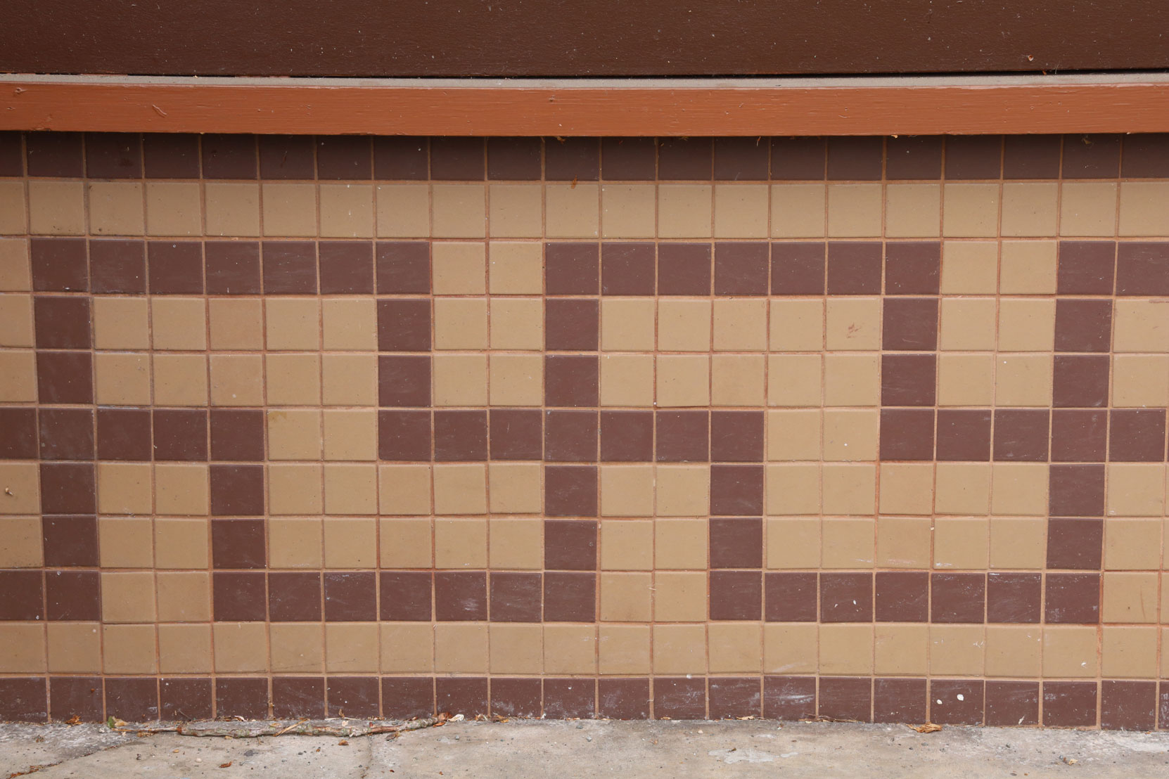 Swastika design in tile on the front of the Travellers Hotel, 422 1st Avenue. This design has nothing to do with the Nazi symbol.
